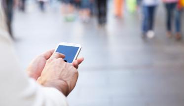 Man-Touching-Smartphone